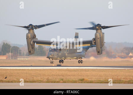 USAF CV-22B Osprey departing and climbing out of RAF Mildenhall at dusk. The 7th Special Operations Squadron is the European operator of the type. - Stock Image