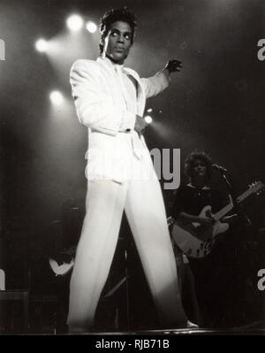 Pop Superstar Prince (1958-2016) performing live on stage at Wembley Arena, London England in August 1986 during The Parade Tour (also called the Under the Cherry Moon Tour) in support of Prince and The Revolution's eighth studio album Parade and his 1986 film 'Under the Cherry Moon'. - Stock Image