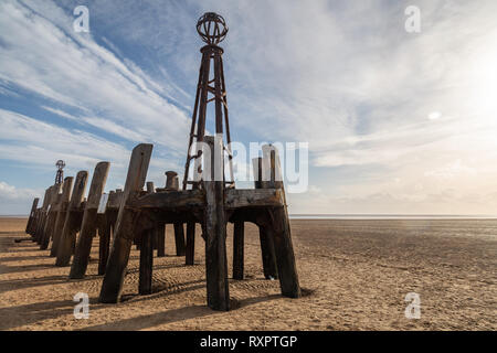 wooden structure designed to limit waves on the pier on the beach at St Annes on Sea Fylde Coast February 2019 - Stock Image
