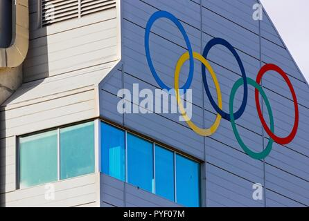 Five Olympic Rings Logo Painted on Wall of Ski Jumping Tower in Canada Olympic Park (COP) in City of Calgary, Alberta - Stock Image