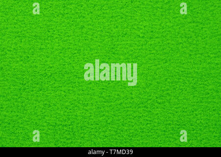 Green spotted surface close up. Texture and background - Stock Image