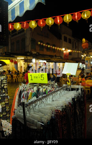 Clothing for sale in Chinatown market. Singapore - Stock Image
