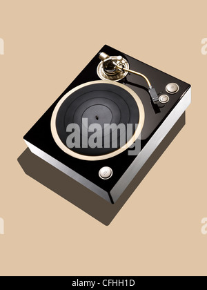 A black record deck on a beige background - Stock Image