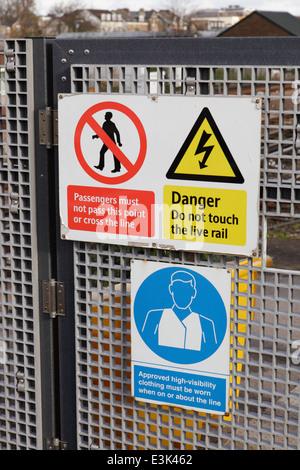 Railway warning signs East Croydon station - Stock Image