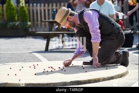 Crawley Sussex, UK. 19th Apr, 2019. Darren Ray from the Handcross 49ers team competing in the World Marbles Championship held at The Greyhound pub at Tinsley Green near Crawley in Sussex . The annual event has been held on Good Friday every year since the 1930s and is open to players from around the world Credit: Simon Dack/Alamy Live News - Stock Image