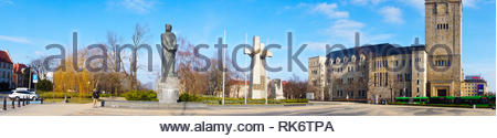 Poznan, Poland - February 6, 2019: Adam Mickiewicz square with sculptures and the imperial castle in the background. Horizontal panorama in colour. - Stock Image