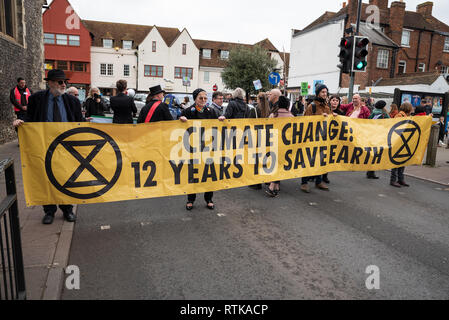 Canterbury, UK. 23rd February 2019. Supporters of the Canterbury Extinction Rebellion Group form up in the City Centre then take part in a symbolic funeral procession representing the death of plants, animals, humans and the planet due to the climate crisis, loss or life. The protest will culminated in a swarming action blocking St. Peters Place. Police were present but didn't interfere, there were no arrests. Credit: Stephen Bell/Alamy Live News Credit: Stephen Bell/Alamy Live News - Stock Image