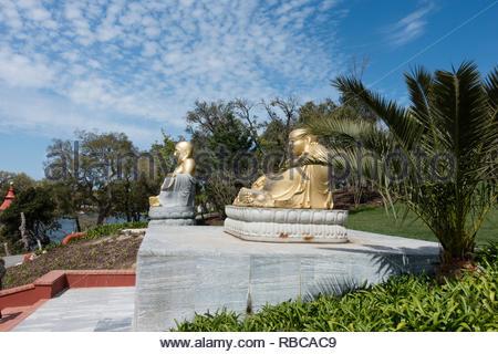 statues at Buddha Eden Gardens, Quinta dos Loridos, Bombarrel, Portugal - Stock Image
