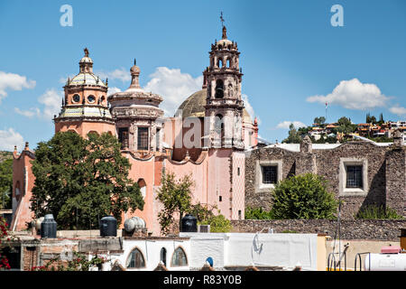 Domes and spires of the Oratorio de San Felipe Neri church in the historic district of San Miguel de Allende, Mexico. The multi-towered, domed church dates from the 18th century and includes baroque and indigenous architectural elements. - Stock Image