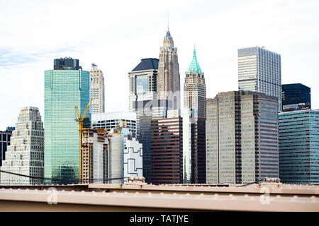 (Selective focus) Close-up view of the Manhattan skyline seen from the beautiful Brooklyn bridge in Manhattan, New York City, USA. - Stock Image