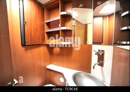 Inside of RV with washroom sink and wardrobe - Stock Image