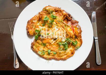 A vegetarian lunchtime meal a Spanish Omelette made with eggs and vegetables - Stock Image