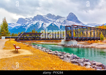 Historic Canmore Engine Bridge is a truss bridge over the Bow River in the Canadian Rockies of Alberta. The bridge was built by the Canadian Pacific R - Stock Image