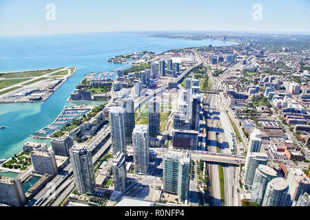 Aerial view of the Toronto's harbourfront cityscape with freeways and Billy Bishop Airport on Toronto Islands on Lake Ontario. - Stock Image
