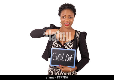 Portrait of a young business woman smiling holding a slate on which it is written reduction. - Stock Image