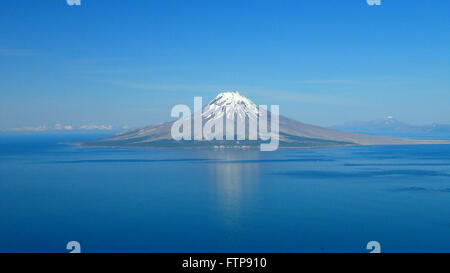 Cone of the Augustine Volcano on Augustine Island in the lower Cook Inlet June 14, 2015 in Alaska. The volcano consists - Stock Image