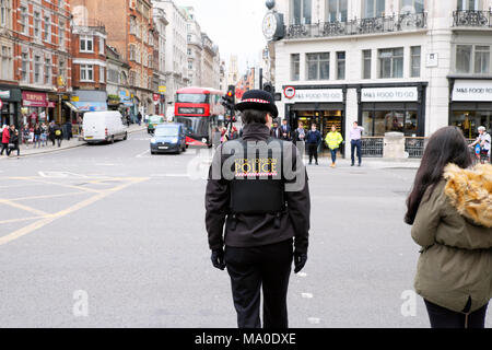 Rear view female policewoman City of London Police in uniform on the street in Central London England UK Great Britain   KATHY DEWITT - Stock Image