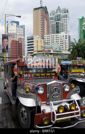 A jeepney sits at an intersection in Makati City, Metro Manila, Philippines. - Stock Image