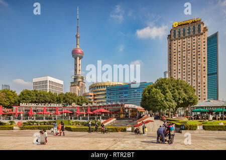 1 December 2018: Shanghai, China - Cafe on the East bank of the Huangpu River, Pudong, Shanghai, with a skyline dominated by the Oriental Pearl Tower. - Stock Image