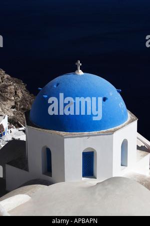 Greek Orthodox Church, Santorini, Greece sitting on a cliff overlooking the Adriatic sea - Stock Image