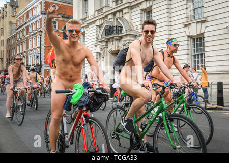 Westminster, Lomdon, UK. 08th June, 2019. Participants have fun biking in the buff despite the cooler London temperatures. Thousands of cyclists take part in the annual Naked Bike Ride through Central London, here cycling down Whitehall from Trafalgar Square. The ride celebrates body freedom and cycling. Credit: Imageplotter/Alamy Live News - Stock Image