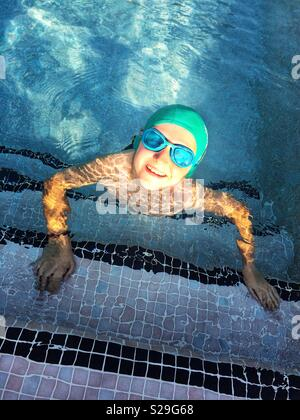 Smiling boy in a swimming pool - Stock Image