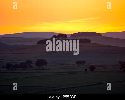 Harborough Rocks, Peak District, UK. 24th June, 2018. Weather UK: Sunset over Minning Low hill Historic England monument with a chambered tomb & two bowl barrows viewed from Harborough Rocks, Peak District National Park, Derbyshire, UK Credit: Doug Blane/Alamy Live News - Stock Image