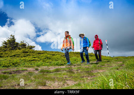 Family having fun on a trekking day - Stock Image