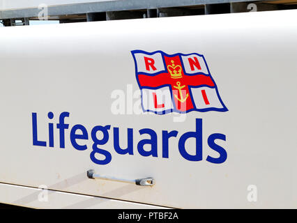 RNLI Lifeguards equipment container by the Lifeguards hut on the seawall at West Runton, Norfolk, England, United Kingdom, Europe. - Stock Image