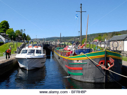 Working the Lock at Fort Augustus between Loch Ness and Loch Oich Scotland - Stock Image