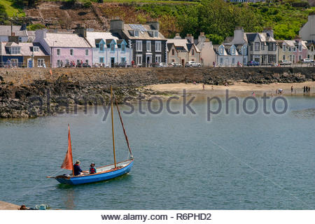Portpatrick, Dumfries and Galloway, Scotland, UK - May 27, 2012: Boat Leaving Portpatrick in Scotland on a sunny day. - Stock Image