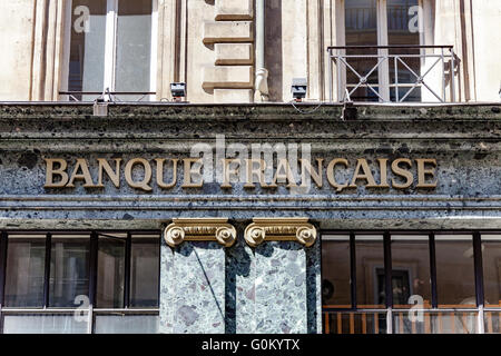 Paris, France - May 1, 2016: Banque Française text sign on a parisian buidling. - Stock Image