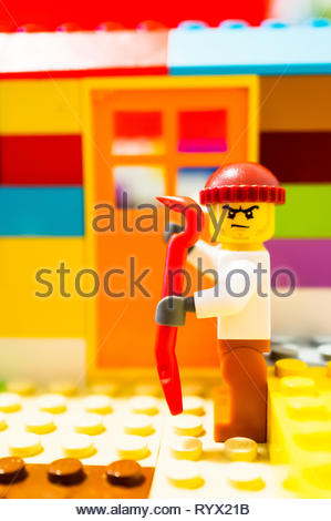 Poznan, Poland - March 14, 2019: Escaped Lego prisoner holding a crowbar planning to break into a house. - Stock Image