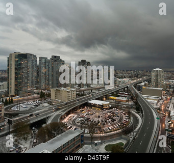 Snow and stormy skies over the northern approach to the Granville Street Bridge, Vancouver, BC, Canada - Stock Image