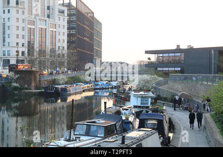 Boats on the Regents Canal at Kings Cross, at dusk, in spring weather, in London, UK - Stock Image