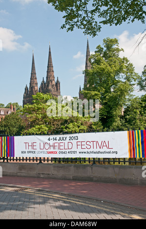 Banner advertising The Lichfield Festival on Minster Pool railings with the three spires of Lichfield Cathedral - Stock Image