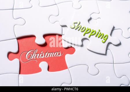 The Words Christmas And Shopping In Missing Piece Jigsaw Puzzle - Stock Image