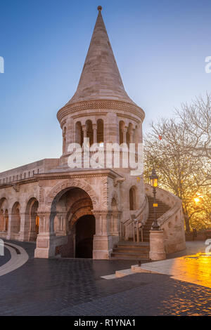 Budapest, Hungary - Sunrise at the entrance tower of the Fisherman's Bastion (Halaszbastya) at autumn with clear blue sky - Stock Image