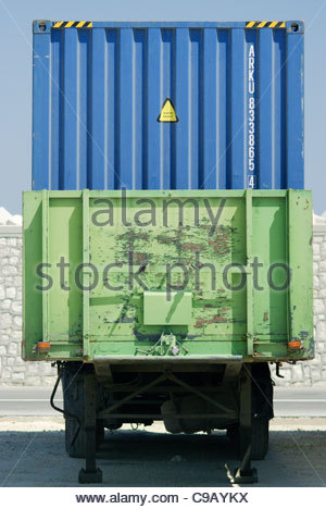 international steel shipping container on back of lorry Greece - Stock Image