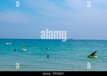 People in water, at Sai Kaew beach, Ko Samet, Thailand - Stock Image