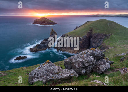 Sunrise over The Rumps near Pentire Head on the north coast of Cornwall, England. Summer (July) 2017. - Stock Image