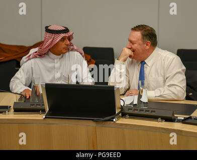 U.S. Secretary of State Michael R. Pompeo chats with Saudi Foreign Minister Adel- Al-Jubeir at a pull aside meeting during the NATO Summit in Brussels, Belgium on July 12, 2018. - Stock Image