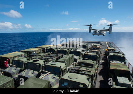 PACIFIC OCEAN (Feb. 19, 2016) An MV-22 Osprey lands on the flight deck of dock landing ship USS Harpers Ferry (LSD - Stock Image