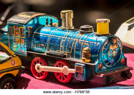 Old but well conserved brass classical toy train on a flee markets in Reus, Tarragona. Spain - Stock Image