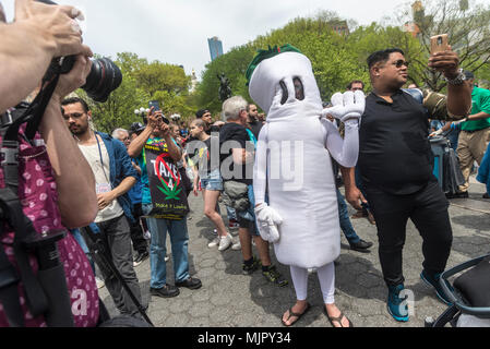 New York, NY, USA - 5 May 2018 - Marijuana advocates rallied in Union Square calling on New York State lawmakers to legalize marijuana for recreational use. People photograph and take selfies of someone dressed as a marijuana cigarette CREDIT ©Stacy Walsh Rosenstock/Alamy Live News - Stock Image