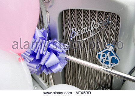 Front grill of Beauford car with baloons and ribbons for weddings or celebrations - Stock Image