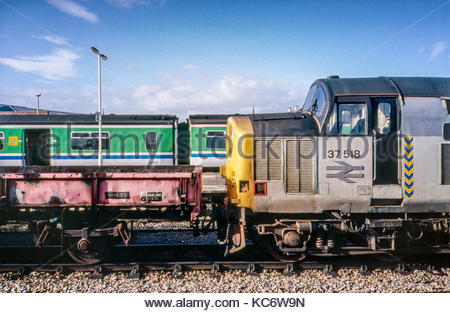 A passenger train, and freight train at Hereford railway station, England, UK – 1991 - Stock Image