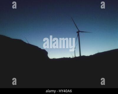 Low Angle View Of Silhouette Windmills Against Clear Sky - Stock Image