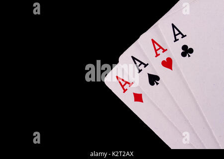 Four Aces playing cards set against a black background. - Stock Image