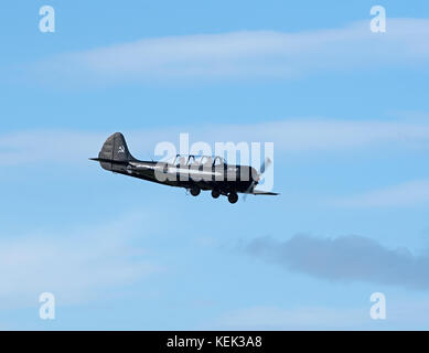 A 1982 Bacau Yak based at Inverness Dalsross Airport in flight to practice aerobatic manoeuvres. - Stock Image
